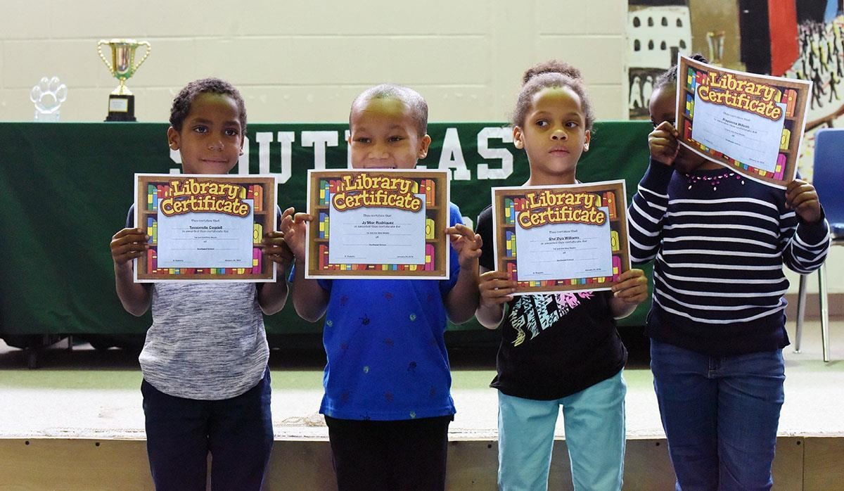 Students display certificates during awards day