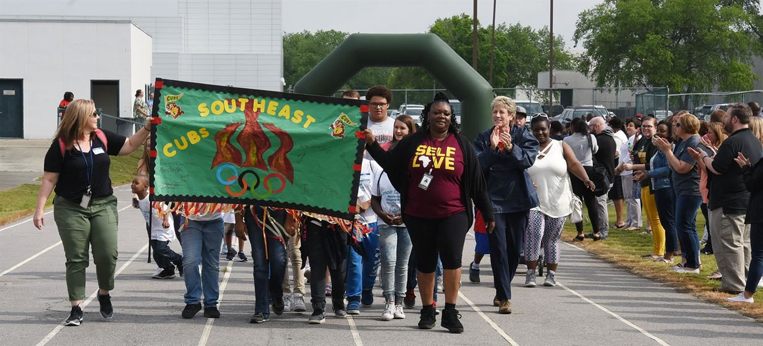 Southeast teams parades during Special Olympics opening ceremony