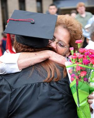 Grandmother hugs Early College graduate.