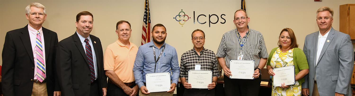 Members of the Migrant Education Team pose with school board members holding certificates of appreciation.