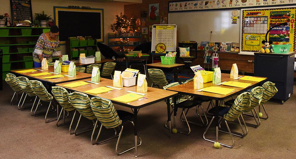 Kindergarten teacher arranges her room the week before school.