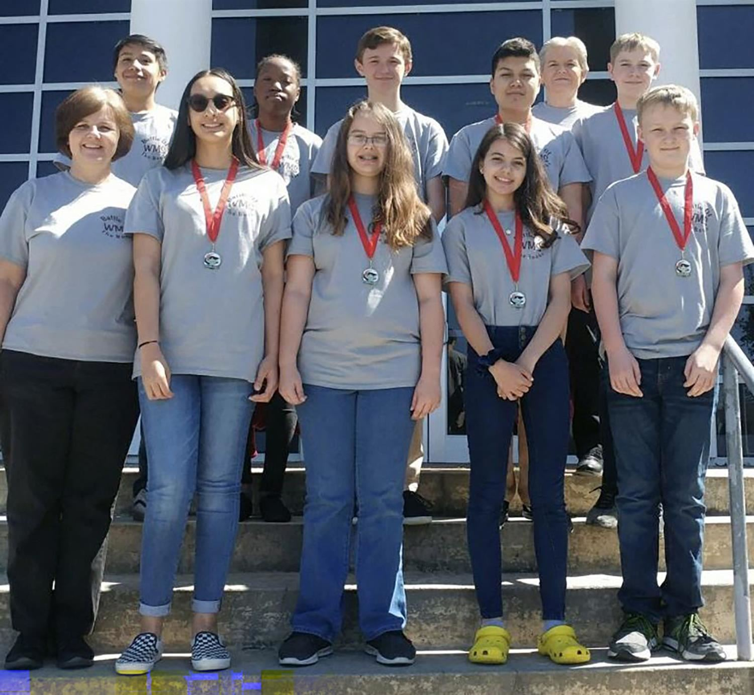 WMS Battle of the Books team poses on steps of Kinston PAC