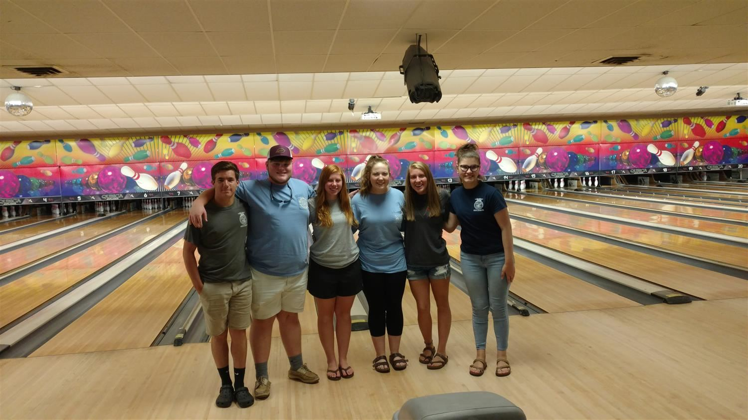Students standing together posing for camera at bowling alley