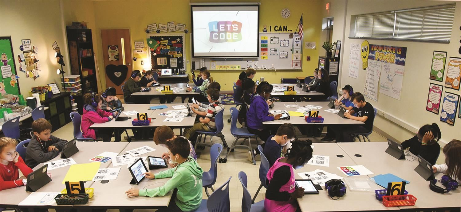 Students use iPads during Hour of Code event