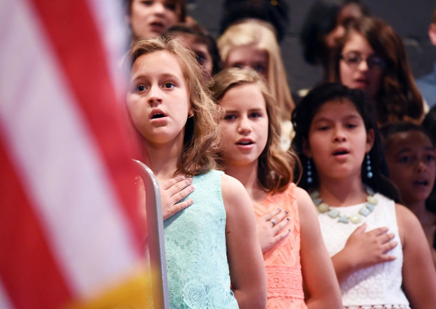 5th graders pledge allegiance during graduation ceremony